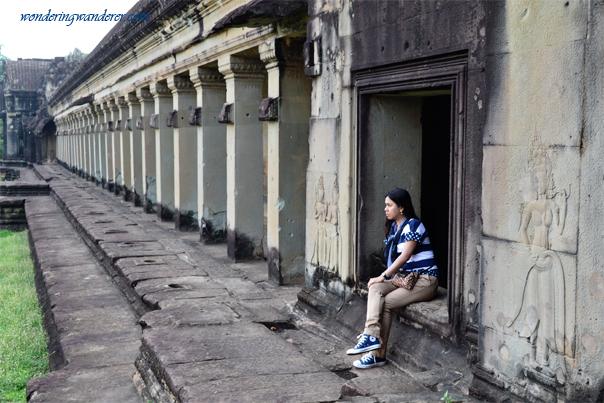 Lady at the pillars of Angkor Wat