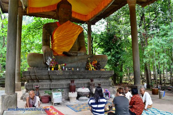 Wat Preah Ngok prayers - Siem Reap, Cambodia