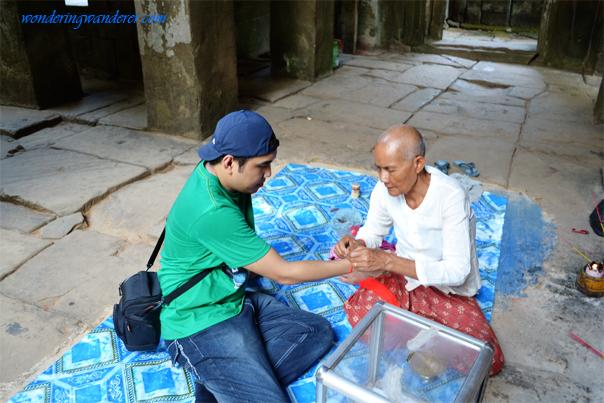 Prayer inside Banteay Kdei - Siem Reap, Cambodia