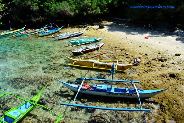 Parked boats near the Underwater Cave - San Antonio Island, Puerto Galera