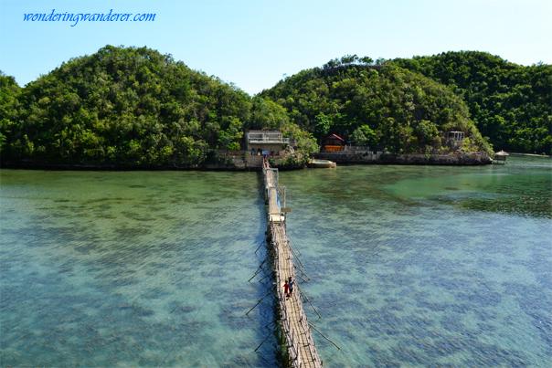 Narrow Wooden Bridge of Tinagong Dagat Island Resort